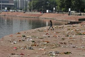 Garbage strewn across the banks of Sector-42 lake after Chhath Puja in Chandigarh on Friday. Even as the organisers took away the tents and chairs set up at the venue, they showed no concern for the puja items, plates, glasses and polybags disposed of at the venue.