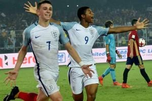 Philip Foden (L) celebrates with Rhian Brewster after scoring a goal during the FIFA U-17 World Cup 2017 final.