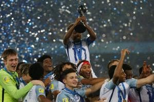 England footballers celebrate with the trophy after winning the FIFA U-17 World Cup title.