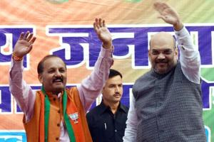 BJP national president Amit Shah (right) with the party's Jawali candidate Arjun Singh in Kangra during an election rally.
