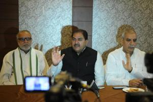 Leader of opposition in the Haryana assembly Abhay Chautala (centre) at a media briefing on Tuesday.