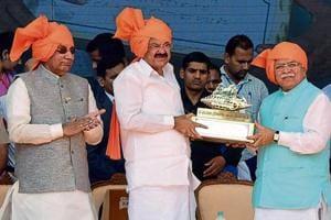 Haryana chief minister Manohar Lal Khattar presenting a memento to vice-president M Venkaiah Naidu at the closing ceremony of Haryana Swarna Jayanti celebrations inHisar on Tuesday. Haryana governor Kaptan Singh Solanki is also seen.
