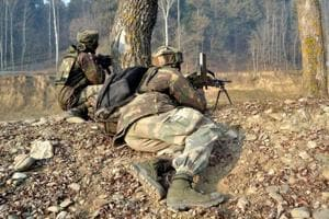 Security personnel in position during an encounter in Kupwara in Jammu and Kashmir.