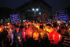 The joint action committee of Sector 17 traders holding a candle march during an hour-long blackout to protest against street vendors at the Plaza in Chandigarh.