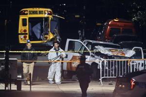 Police work near a damaged Home Depot truck after a motorist drove onto a bike path near the World Trade Center memorial, striking and killing several people on November 1, 2017.