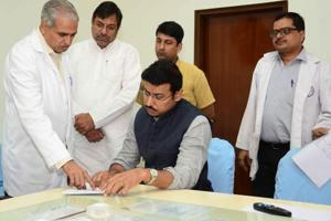 Union minister Rajyavardhan Singh Rathore  takes a look at the treatment plan those injured in the transformer explosion at Khatauli village, at SMS Hospital in Jaipur on Tuesday.