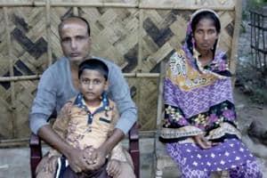 Kismat Ali with son Isfan, 7, and wife Sajeda Begum.