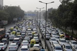 """Vehicles at a traffic intersection in New Delhi. The ministry of road transport and highways has said  motor vehicles """"sold on and after December 1, 2017 shall be fitted with FASTag""""."""