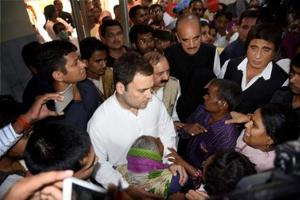 Congress vice-president Rahul Gandhi meets with the family members of victims of Unchahar NTPC boiler blast in Rae Bareli on Thursday.