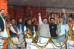 BJP's CM candidate Prem Kumar Dhumal and party's national president Amit Shah during an election rally at Gandhi Chowk in Hamirpur, Himachal Pradesh, on Wednesday.