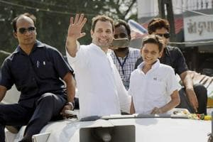 Congress vice-president Rahul Gandhi waving to the crowd during his road show at Valsad district, in Gujarat on Friday.