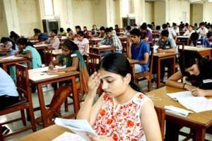 Students taking the entrance exams for MBBS courses at the post-graduation institute of medical science in Rohtak.