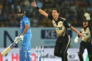 Trent Boult (C) appeals successfully against Rohit Sharma during the second India vs New Zealand T20 international in Rajkot.