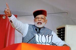 Prime Minister Narendra Modi waves at crowd during BJP Parivartan Rally at Rait near Dharamsala on Saturday.
