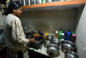 A housewife stores water to counter water shortage in Delhi. Though women's work helps men to be productive, this contribution is largely unnoticed.