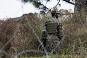 An Indian Army soldier patrols at the LoC in Poonch district of Jammu and Kashmir.