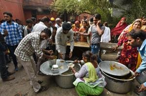 Locals living near Kathputli Colony providing food to the evicted residents.