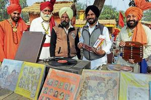 Bheem Lubaneawala (in yellow turban) of Nabha along with his 90-year-old gramophone and old music records at the Chandigarh National Crafts Mela at Kalagram.