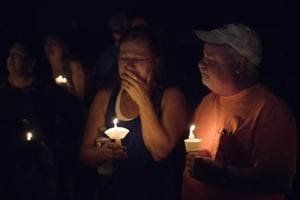 Mourners participate in a candlelight vigil for the victims of a fatal shooting at the First Baptist Church of Sutherland Springs, in Sutherland Springs, Texas. A man dressed in black tactical-style gear and armed with an assault rifle opened fire inside the church in the small South Texas community, killing at least 26.