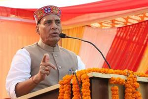 Home minister Rajnath Singh addressing a public meeting at Arki, Shimla on Monday.