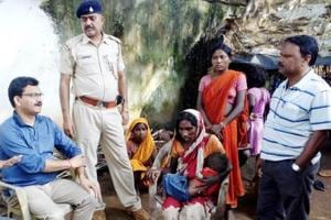 District administration officials with police visiting the family members of 11-year-old Santoshi who died of starvation