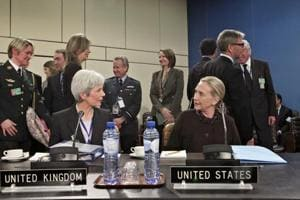 Mariot Leslie with US secretary of state Hillary Clinton at a conference at the NATO headquarters, Brussels, December 7, 2011