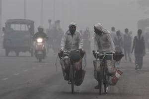 Commuters drive amid heavy smog in New Delhi on Tuesday. The city woke up to a choking blanket of smog as air quality in the world