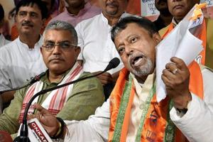 Mukul Roy addresses media during his first visit to the state BJP office after his induction into the party, in Kolkata on Monday. West Bengal BJP President Dilip Ghosh is also seen.