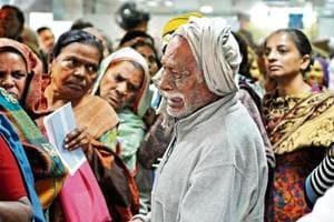 This HT photo by Praveen Kumar of an old man crying after missing his spot at the State Bank of India's New Colony branch in Gurgaon went viral on Twitter.