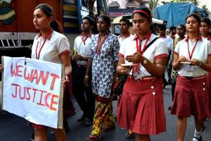 Students from the Convent of Jesus and Mary in Ranaghat, 70km north of Kolkata, protest the rape of a 71-year-old nun.