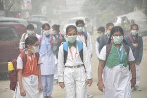 School children braved dense smog on Wednesday with face masks in Ghaziabad.