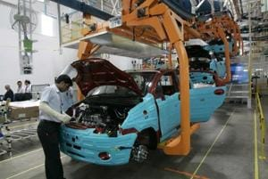 A worker assembles a new vehicle at a plant near Mumbai. Indian businesses have identified shortage of finance and lack of skilled workforce as pain points.