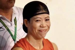 Mary Kom celebrates after winning her fifth Asian Boxing Championship gold medal in Ho Chi Minh City in Vietnam on Wednesday.
