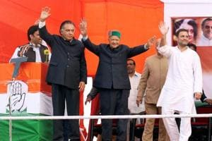 Congress vice-president Rahul Ghandhi with Himachal Pradesh CM Virbhadra Singh waves to a crowd at an election rally at Nagrota in Kangra.