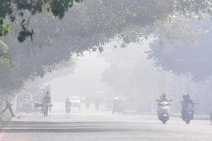 Smog in Mohali on Wednesday noon. A mix of smoke and fog, the phenomenon causes respiratory problems.