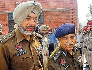 Director general of police Suresh Arora (right) with SSP Raj Jit Singh in Moga on Wednesday.