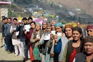 Women show their voting cards before casting their ballot in the Himachal Pradesh assembly elections at Theog in Shimla district on Thursday.