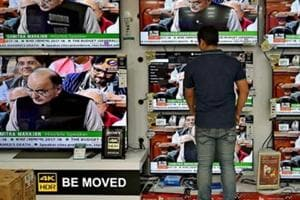 A man watches the Union Budget 2017-18 presentation by finance minister Arun Jaitley on TV at a showroom in Kolkata in February 2017.