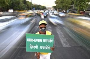 A civil defence volunteer promoting the second edition of odd-even scheme at ITO in New  Delhi in April 2016.