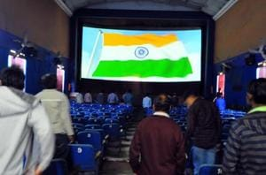 Citizens stand as the national anthem is played before a movie at a theatre. The BJP government in Jharkhand will make singing of the national anthem mandatory in madrasas and schools.