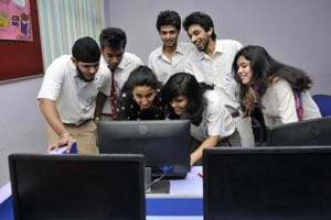 Students check their CBSE XII board exam results in May 2014. Till now, students could correct details such as their name, date of birth and parents' names within a year of exam results being declared.