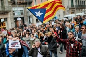 A man holds a Catalan pro-independence