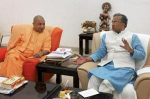 UP chief minister Yogi Adityanath with his Uttrakhand counterpart Trivendra Singh Rawat at a meeing in Lucknow on November 11, 2017.