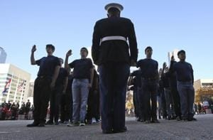 US Marine recruits take the Oath of Enlistment before the start of a Veterans Day parade in Dallas, Friday, Nov. 10, 2017.