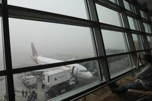 In foggy conditions, airports and aircraft use sophisticated landing systems with pilots trained to deal with low visibility, known as Category-III or CAT-III.