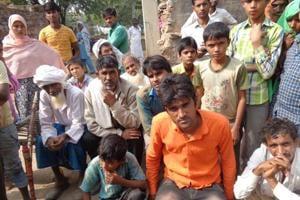 Deceased Ummar Mohammed's brother Khurshid (in orange shirt) with other family members.