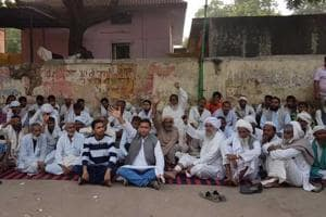Meo community member stage a dharna outside the Rajiv Gandhi Government General Hospital against the alleged killing of Umar Khan by cow vigilantes.