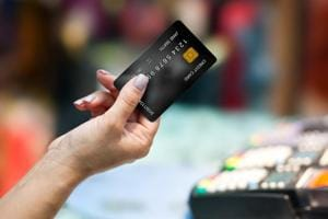 The downside of going cashless: People who pay by card forget how much...