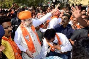 BJP national president Amit Shah meeting the residents of Naranpura during his door-to-door campaign for Assembly polls, in Ahmedabad, Gujarat on October 7.