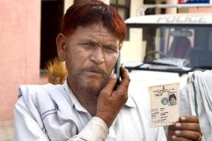 Ilyas Khan, uncle of Ummar Mohammed who was killed in Alwar Friday morning, shows his voter ID.